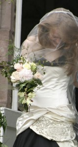 Meredith's wedding bouquet was inspired by the heirloom fabric that she had incorporated into her wonderful dress.