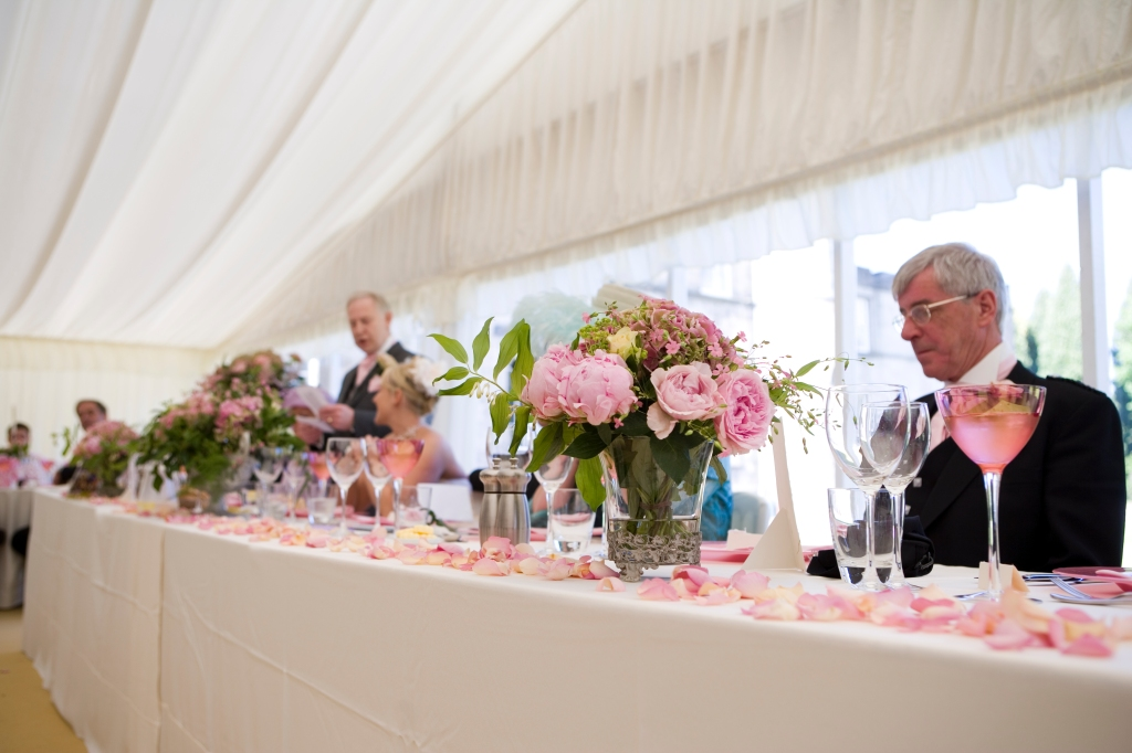 Hues of pink in the wedding marquee.